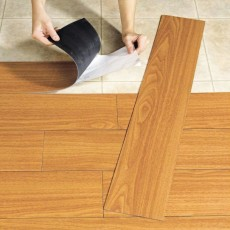 gluing vinyl tiles on the floor