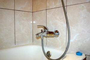 replace the faucet in the bathroom